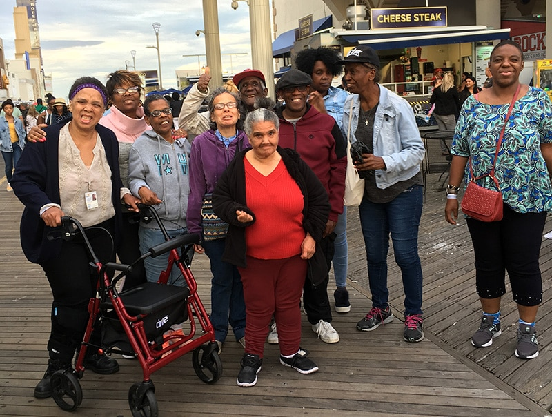 People on a boardwalk down by the Jersey shore