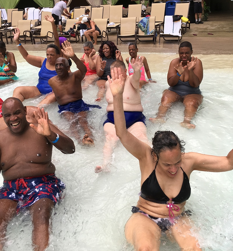 People have fun in the pool at a water park