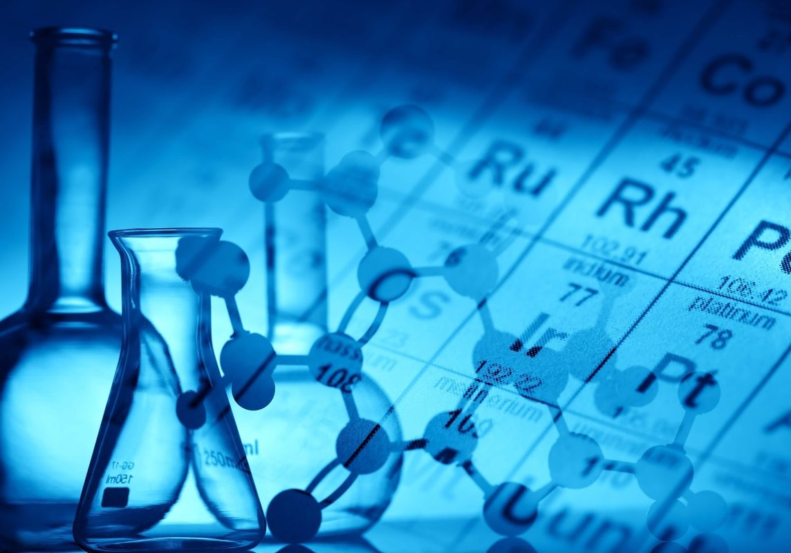 Chemistry lab equipment, periodic table and compound elements